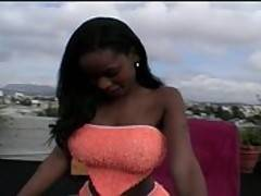 A busty black babe is fucked outside on a balcony
