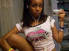 Sexy wide eyed ebony teen babe fingering her hot cunt