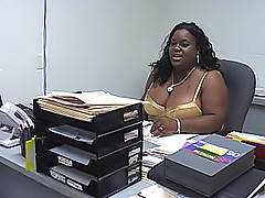A curvaceous black secretary gets bent over her desk and rammed in her chubby shaved pussy