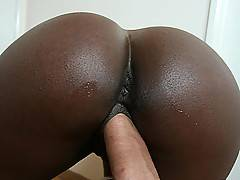 Trashy ebony slut with huge ass fucks a couple guys outside