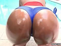 Naughty black sweetie gets her nice big ass oiled.