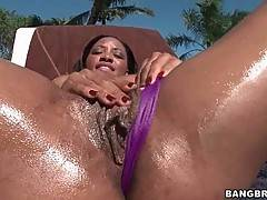 Ebony cutie presents her sexy oiled chocolate body.