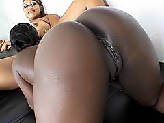 Two black chicks with dripping wet snatches get their holes slammed by pleasing fuck toys