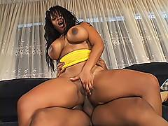 These humongous black tits bounce up and down when she's riding a meat pole in her asshole