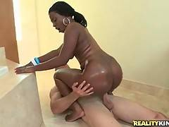 Booty black babe and white guy perform nice rodeo in bathroom.